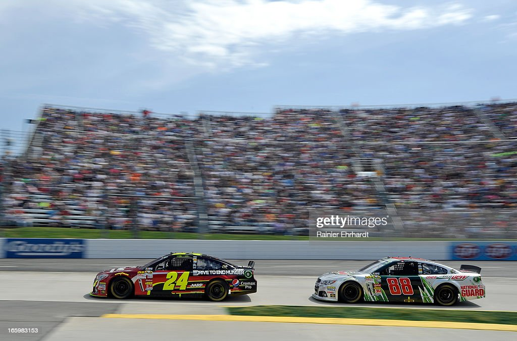 Jeff Gordon, driver of the #24 Drive To End Hunger Chevrolet, leads Dale Earnhardt Jr., driver of the #88 Diet Mountain Dew Chevrolet, during the NASCAR Sprint Cup Series STP Gas Booster 500 on April 7, 2013 at Martinsville Speedway in Ridgeway, Virginia.