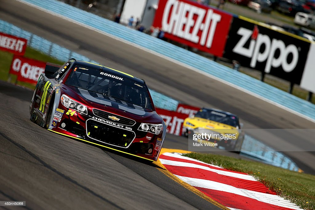 Jeff Gordon, driver of the #24 Drive to End Hunger Chevrolet, leads Marcos Ambrose, driver of the #9 Stanley Ford, during the NASCAR Sprint Cup Series Cheez-It 355 at Watkins Glen International on August 10, 2014 in Watkins Glen, New York.