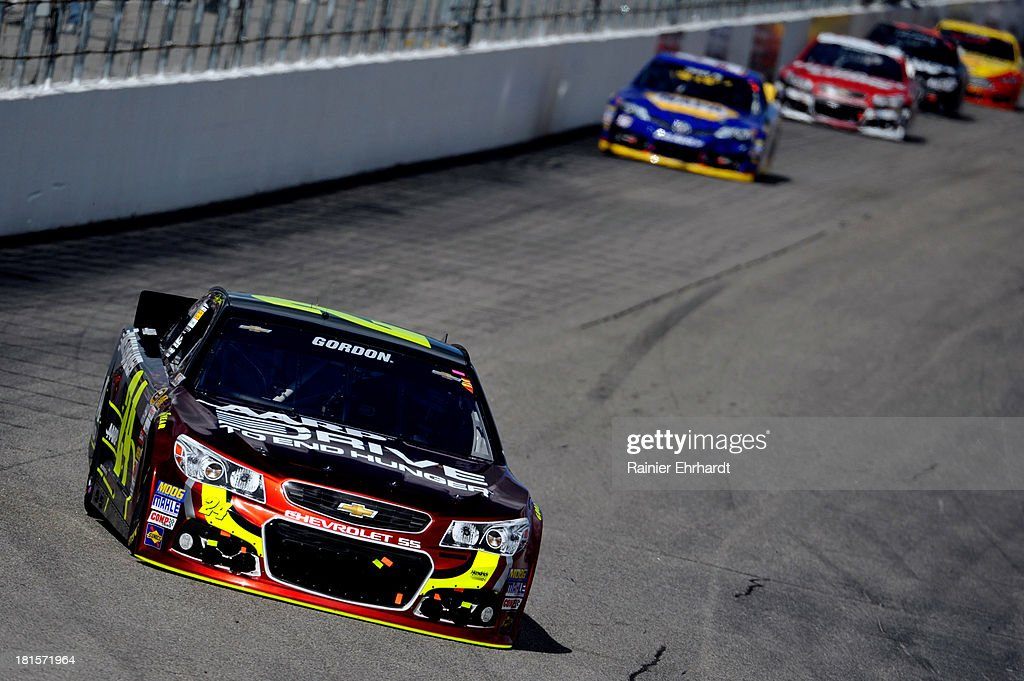 <a gi-track='captionPersonalityLinkClicked' href=/galleries/search?phrase=Jeff+Gordon&family=editorial&specificpeople=171491 ng-click='$event.stopPropagation()'>Jeff Gordon</a>, driver of the #24 Drive to End Hunger Chevrolet, leads <a gi-track='captionPersonalityLinkClicked' href=/galleries/search?phrase=Martin+Truex+Jr.&family=editorial&specificpeople=184514 ng-click='$event.stopPropagation()'>Martin Truex Jr.</a>, driver of the #56 NAPA Auto Parts Toyota, during the NASCAR Sprint Cup Series Sylvania 300 at New Hampshire Motor Speedway on September 22, 2013 in Loudon, New Hampshire.