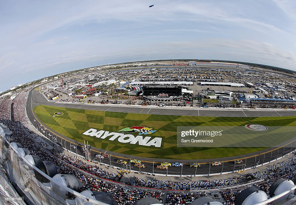 Jeff Gordon driver of the Drive To End Hunger Chevrolet leads the field during the NASCAR Sprint Cup Series Budweiser Duel 2 at Daytona International...