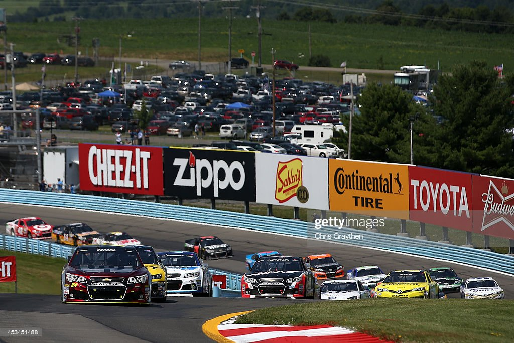 Jeff Gordon driver of the Drive to End Hunger Chevrolet leads the field during the NASCAR Sprint Cup Series CheezIt 355 at Watkins Glen International...