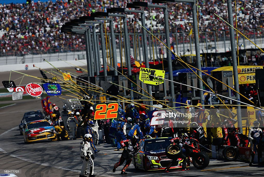 <a gi-track='captionPersonalityLinkClicked' href=/galleries/search?phrase=Jeff+Gordon&family=editorial&specificpeople=171491 ng-click='$event.stopPropagation()'>Jeff Gordon</a>, driver of the #24 Drive To End Hunger Chevrolet, pits during the NASCAR Sprint Cup Series Kobalt Tools 400 at Las Vegas Motor Speedway on March 10, 2013 in Las Vegas, Nevada.