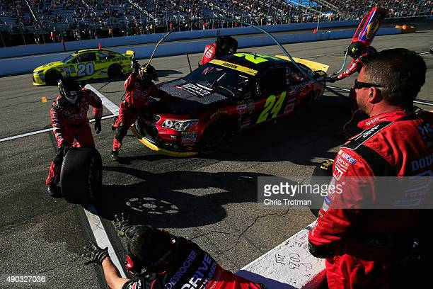 Jeff Gordon driver of the Drive To End Hunger Chevrolet pits during the NASCAR Sprint Cup Series SYLVANIA 300 at New Hampshire Motor Speedway on...