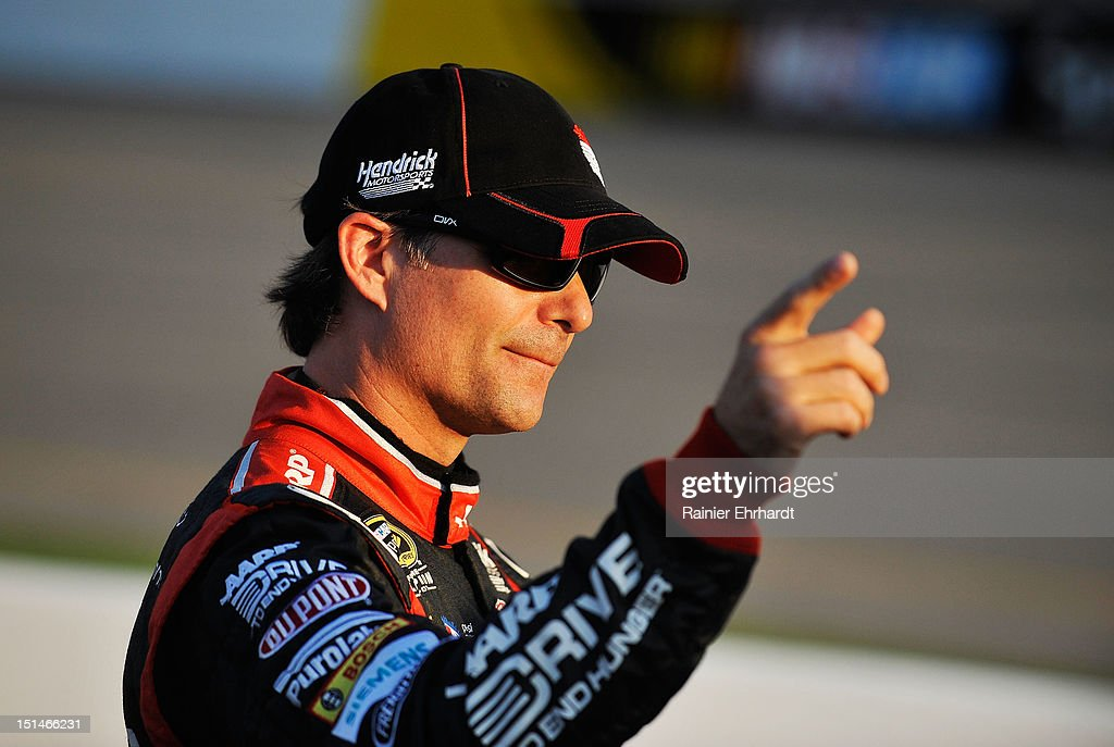 <a gi-track='captionPersonalityLinkClicked' href=/galleries/search?phrase=Jeff+Gordon&family=editorial&specificpeople=171491 ng-click='$event.stopPropagation()'>Jeff Gordon</a>, driver of the #24 Drive to End Hunger Chevrolet, points during qualifying for the NASCAR Sprint Cup Series Federated Auto Parts 400 at Richmond International Raceway on September 7, 2012 in Richmond, Virginia.
