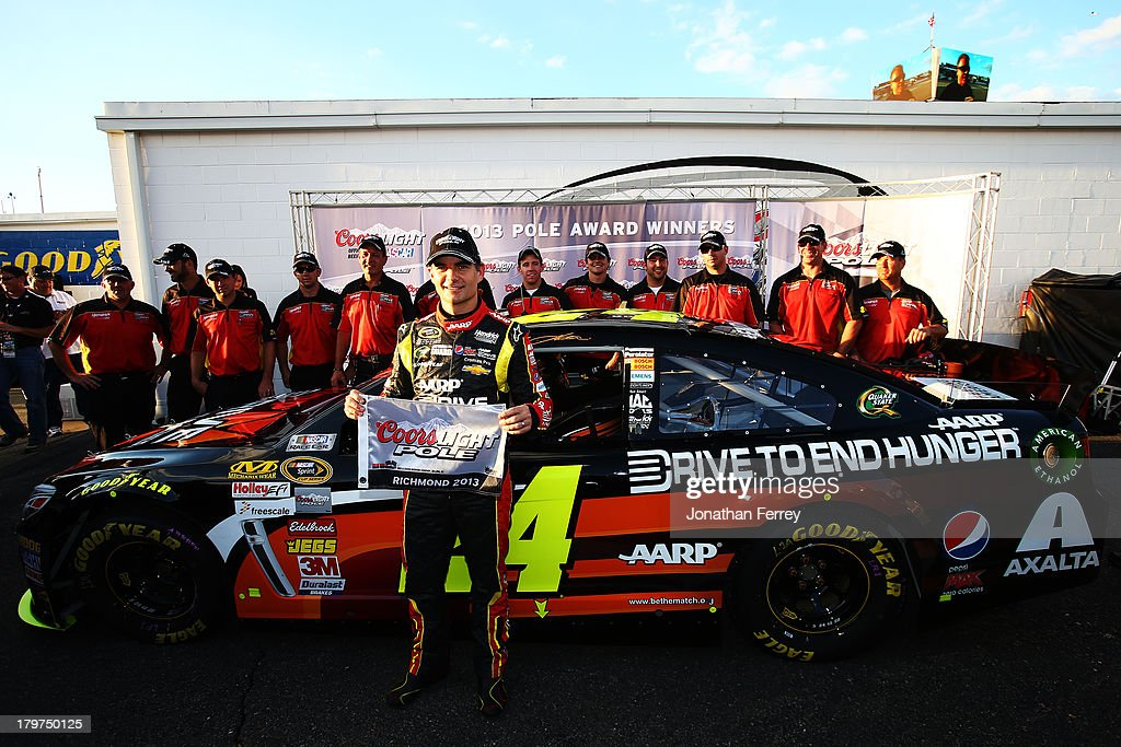<a gi-track='captionPersonalityLinkClicked' href=/galleries/search?phrase=Jeff+Gordon&family=editorial&specificpeople=171491 ng-click='$event.stopPropagation()'>Jeff Gordon</a>, driver of the #24 Drive to End Hunger Chevrolet, poses with the Coors Light Pole Award after qualifying on the pole for the NASCAR Sprint Cup Series Federated Auto Parts 400 at Richmond International Raceway on September 6, 2013 in Richmond, Virginia.
