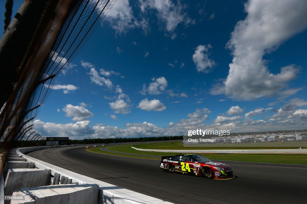 <a gi-track='captionPersonalityLinkClicked' href=/galleries/search?phrase=Jeff+Gordon&family=editorial&specificpeople=171491 ng-click='$event.stopPropagation()'>Jeff Gordon</a>, driver of the #24 Drive To End Hunger Chevrolet, races during the NASCAR Sprint Cup Series GoBowling.com 400 at Pocono Raceway on August 4, 2013 in Long Pond, Pennsylvania.