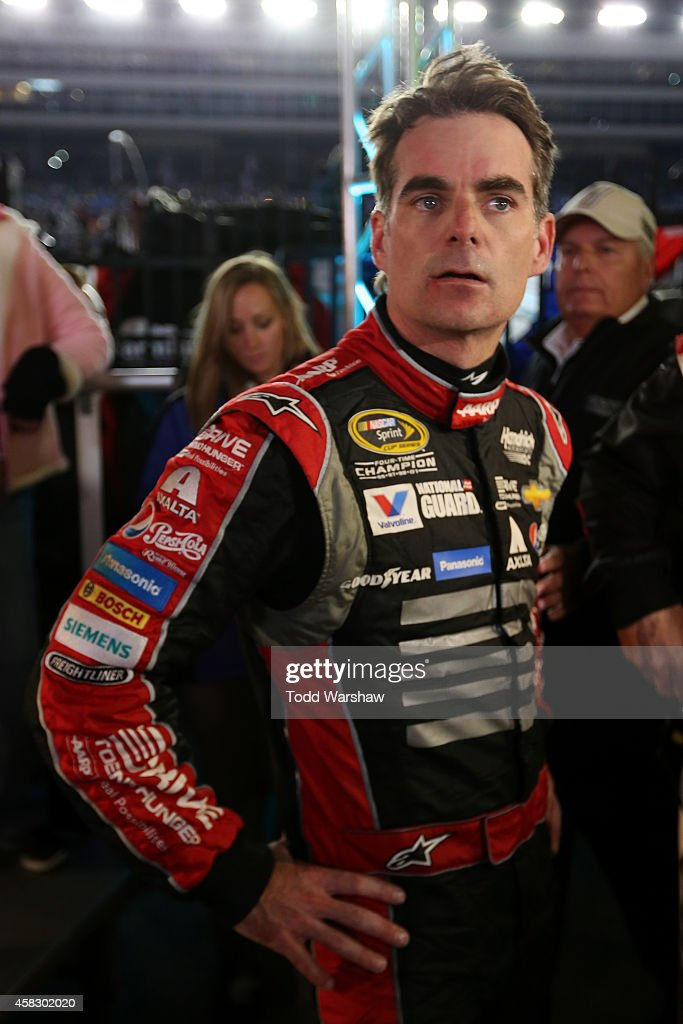 Jeff Gordon, driver of the #24 Drive To End Hunger Chevrolet, reacts after being involved in a fight with Brad Keselowski, driver of the #2 Miller Lite Ford, at the conclusion of the NASCAR Sprint Cup Series AAA Texas 500 at Texas Motor Speedway on November 2, 2014 in Fort Worth, Texas.