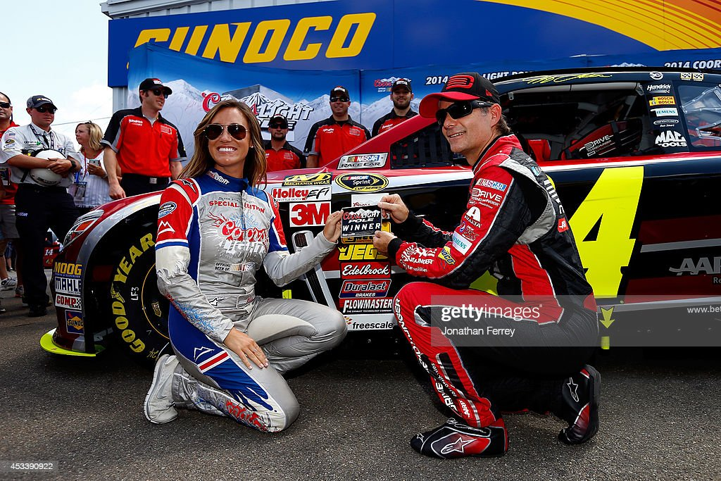 <a gi-track='captionPersonalityLinkClicked' href=/galleries/search?phrase=Jeff+Gordon&family=editorial&specificpeople=171491 ng-click='$event.stopPropagation()'>Jeff Gordon</a>, driver of the #24 Drive to End Hunger Chevrolet, right, and Miss Coors Light Rachel Rupert pose with the Coors Light Pole Award after Gordon qualified for the pole for the NASCAR Sprint Cup Series Cheez-It 355 at Watkins Glen International on August 9, 2014 in Watkins Glen, New York.