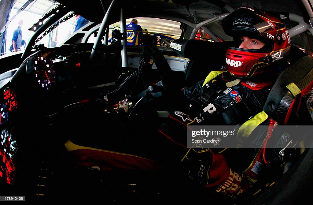 Jeff Gordon, driver of the #24 Drive To End Hunger Chevrolet, sits in his car during practice for the NASCAR Sprint Cup Series AdvoCare 500 at Atlanta Motor Speedway on August 31, 2013 in Hampton, Georgia.