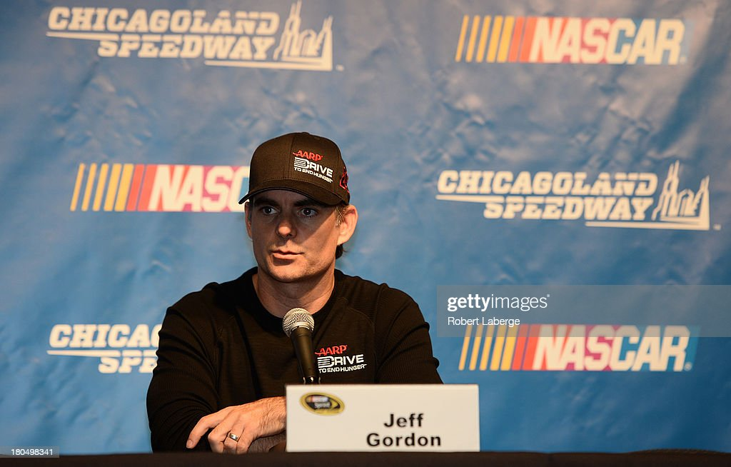 <a gi-track='captionPersonalityLinkClicked' href=/galleries/search?phrase=Jeff+Gordon&family=editorial&specificpeople=171491 ng-click='$event.stopPropagation()'>Jeff Gordon</a>, driver of the #24 Drive To End Hunger Chevrolet, speaks at a press conference during practice for the NASCAR Sprint Cup Series Geico 400 at Chicagoland Speedway on September 13, 2013 in Joliet, Illinois. Gordon was awarded a 13th spot in the Chase for the Sprint Cup by NASCAR.