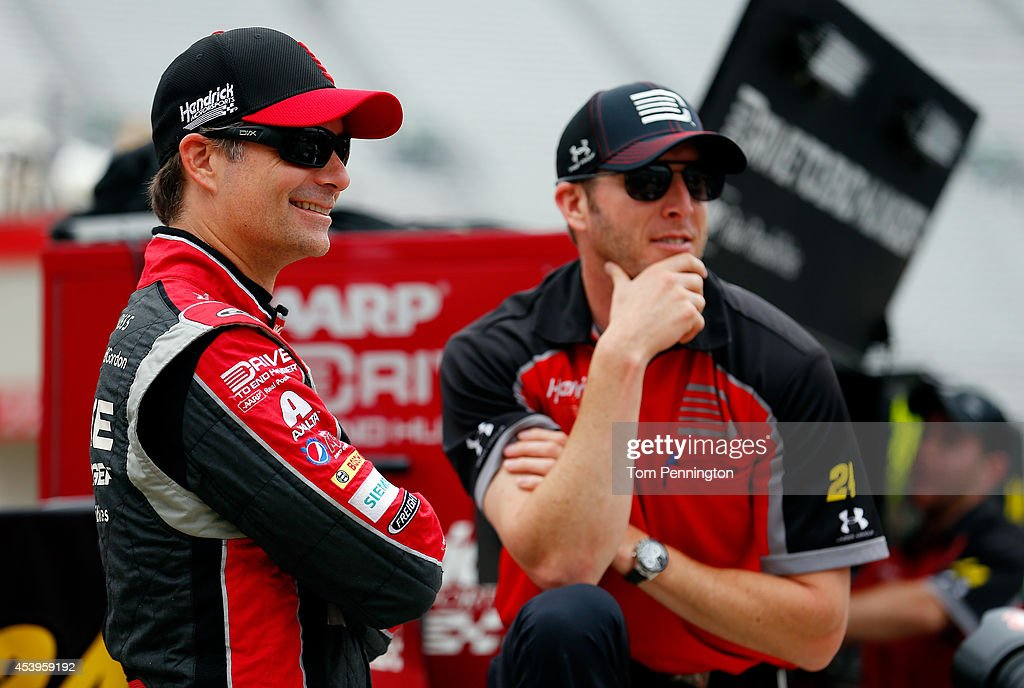 Jeff Gordon driver of the Drive To End Hunger Chevrolet speaks with crew chief Alan Gustafson during practice for the NASCAR Sprint Cup Series Irwin...