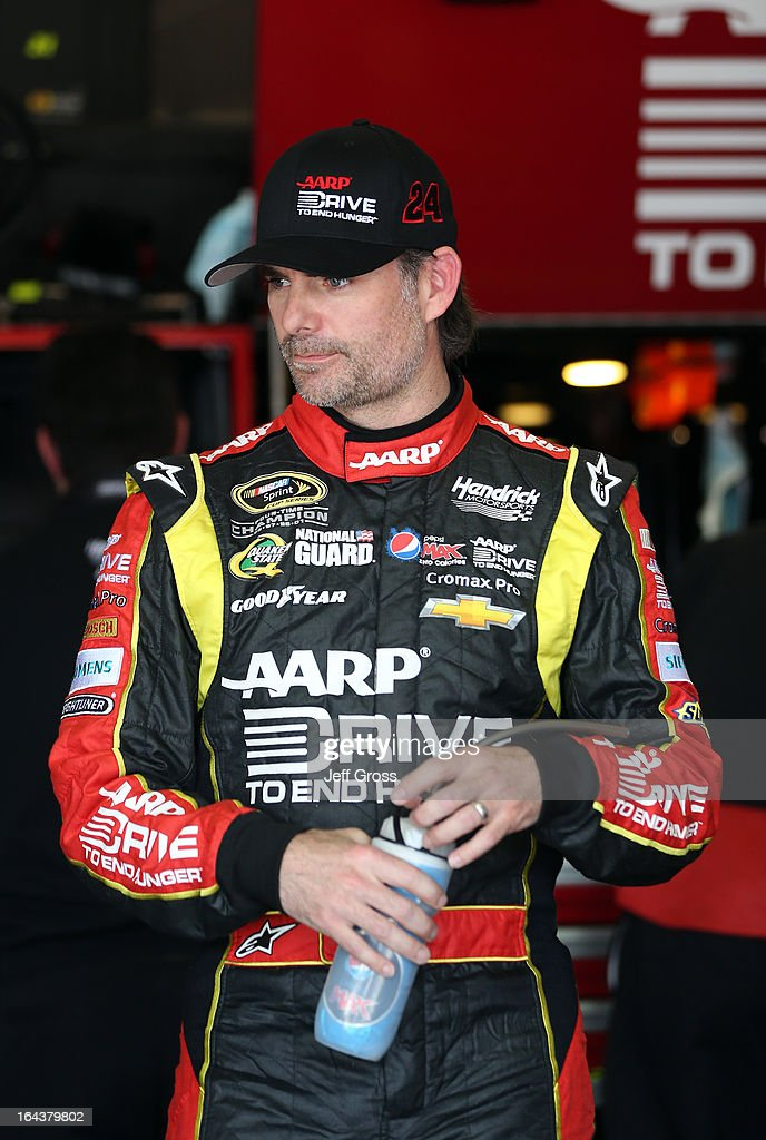 <a gi-track='captionPersonalityLinkClicked' href=/galleries/search?phrase=Jeff+Gordon&family=editorial&specificpeople=171491 ng-click='$event.stopPropagation()'>Jeff Gordon</a>, driver of the #24 Drive To End Hunger Chevrolet, stands in the garage area during practice for the NASCAR Sprint Cup Series Auto Club 400 at Auto Club Speedway on March 23, 2013 in Fontana, California.