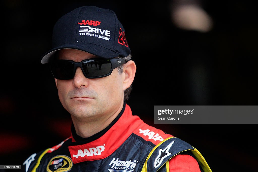 Jeff Gordon, driver of the #24 Drive To End Hunger Chevrolet, stands in the garage area during practice for the NASCAR Sprint Cup Series AdvoCare 500 at Atlanta Motor Speedway on August 31, 2013 in Hampton, Georgia.