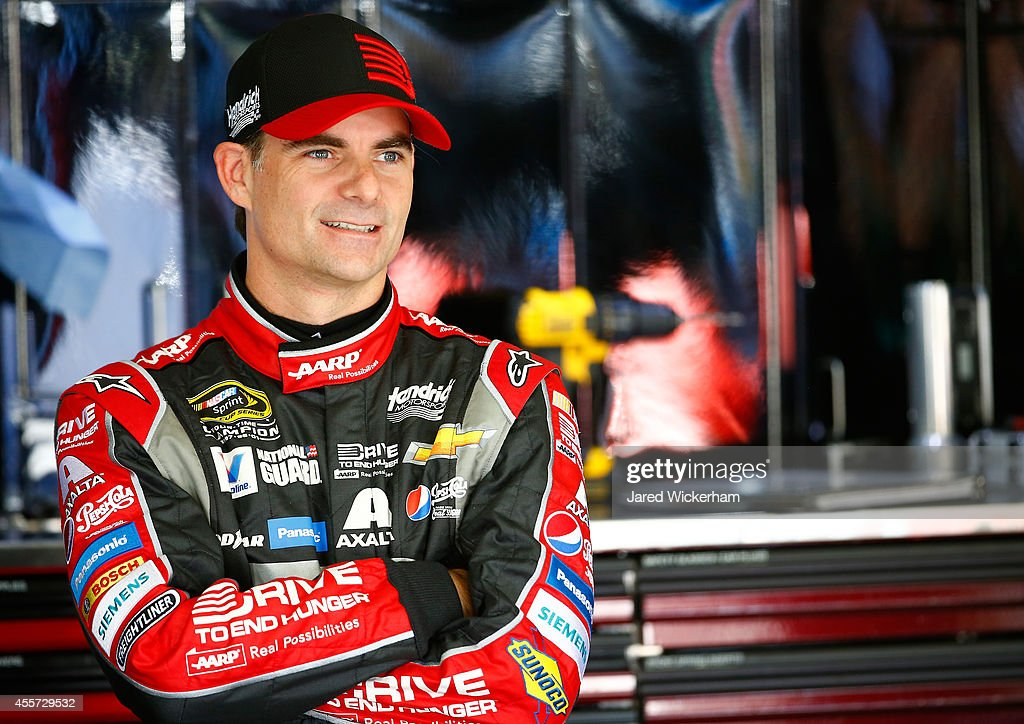 Jeff Gordon, driver of the #24 Drive To End Hunger Chevrolet, stands in the garage area during practice for the NASCAR Sprint Cup Series Sylvania 300 at New Hampshire Motor Speedway on September 19, 2014 in Loudon, New Hampshire.