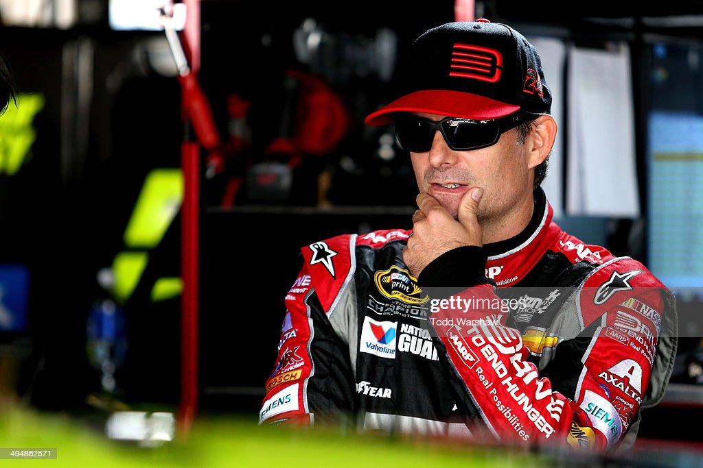 <a gi-track='captionPersonalityLinkClicked' href=/galleries/search?phrase=Jeff+Gordon&family=editorial&specificpeople=171491 ng-click='$event.stopPropagation()'>Jeff Gordon</a>, driver of the #24 DRive to End Hunger Chevrolet, stands in the garage area during practice for the NASCAR Sprint Cup Series FedEx 400 Benefiting Autism Speaks at Dover International Speedway on May 31, 2014 in Dover, Delaware.
