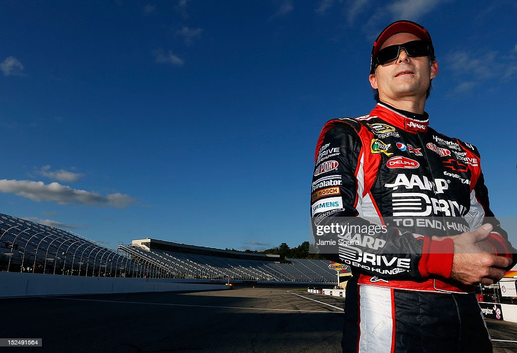 <a gi-track='captionPersonalityLinkClicked' href=/galleries/search?phrase=Jeff+Gordon&family=editorial&specificpeople=171491 ng-click='$event.stopPropagation()'>Jeff Gordon</a>, driver of the #24 Drive to End Hunger Chevrolet, stands on the grid after qualifying for the NASCAR Sprint Cup Series Sylvania 300 at New Hampshire Motor Speedway on September 21, 2012 in Loudon, New Hampshire.
