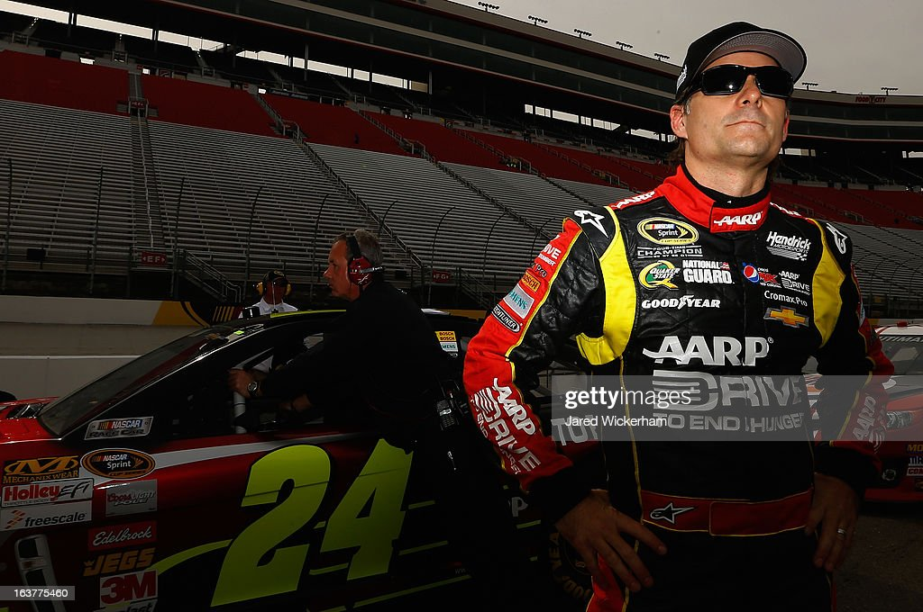<a gi-track='captionPersonalityLinkClicked' href=/galleries/search?phrase=Jeff+Gordon&family=editorial&specificpeople=171491 ng-click='$event.stopPropagation()'>Jeff Gordon</a>, driver of the #24 Drive To End Hunger Chevrolet, stands on the grid after qualifying for the NASCAR Sprint Cup Series Food City 500 at Bristol Motor Speedway on March 15, 2013 in Bristol, Tennessee.