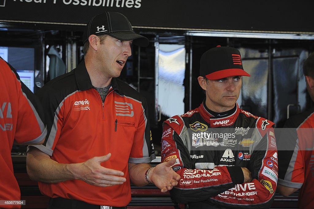 Jeff Gordon driver of the Drive To End Hunger Chevrolet talks to crew chief Alan Gustafson during practice for the NASCAR Sprint Cup Series Quaker...