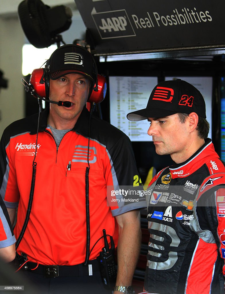 Jeff Gordon driver of the Drive To End Hunger Chevrolet talks to crew chief Alan Gustafson in the garage area during practice for the NASCAR Sprint...