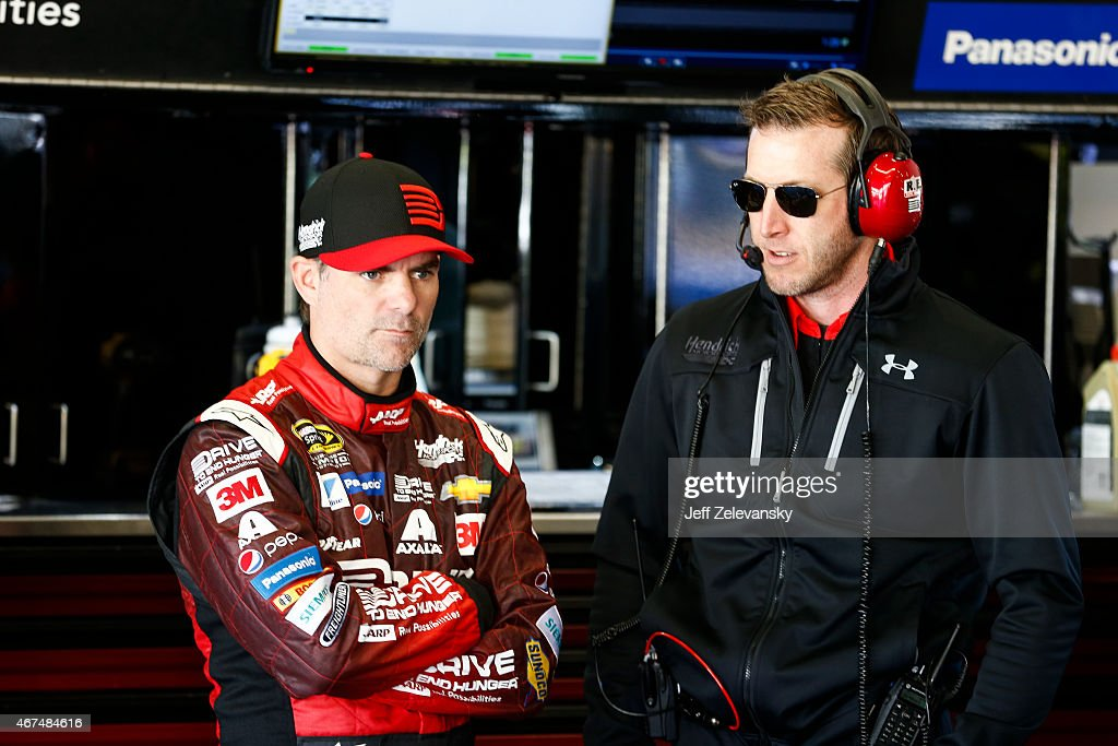 Jeff Gordon driver of the Drive To End Hunger Chevrolet talks to crew chief Alan Gustafson during practice for the 57th Annual Daytona 500 at Daytona...