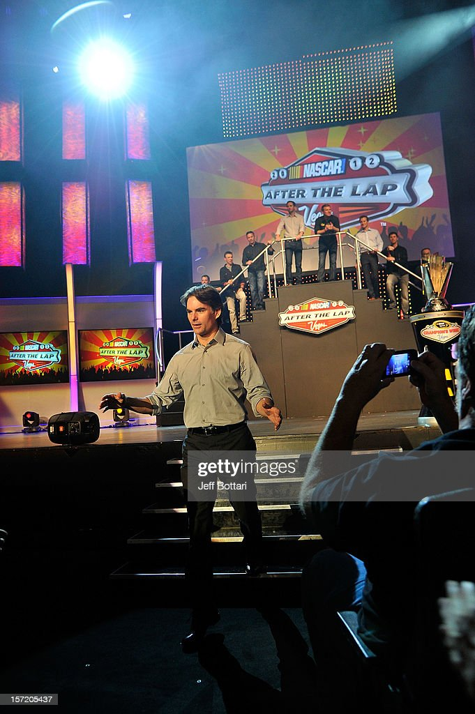 Jeff Gordon, driver of the #24 DuPont 20 Years Celebratory Chevrolet, high-fives fans during NASCAR After The Lap at PH Live at Planet Hollywood Resort & Casino on November 29, 2012 in Las Vegas, Nevada.