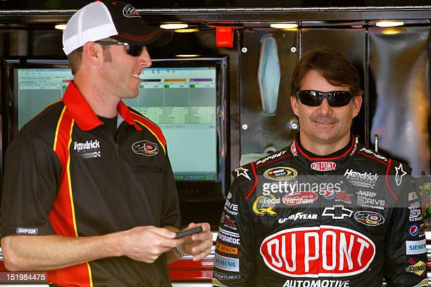 Jeff Gordon driver of the DuPont Chevrolet and Gordon's crew chief Alan Gustafson look on in the garage during practcie for the NASCAR Sprint Cup...
