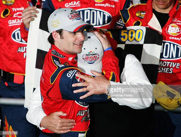 Jeff Gordon driver of the Dupont Chevrolet celebrates his victory with team owner Rick Hendrick during the NASCAR Nextel Cup Daytona 500 on February...