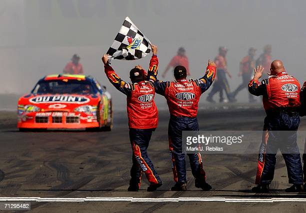 Jeff Gordon driver of the DuPont Chevrolet celebrates his win after the NASCAR Nextel Cup Series Dodge/Save Mart 350 at the Infineon Raceway June 25...