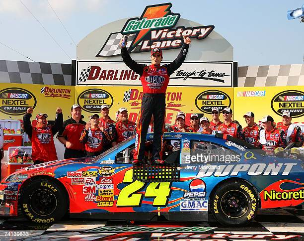 Jeff Gordon driver of the DuPont Chevrolet celebrates in victory lane after winning NASCAR Nextel Cup Series Dodge Avenger 500 on May 13 2007 at...