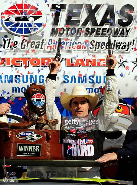 Jeff Gordon driver of the DuPont Chevrolet celebrates in victory lane after winning the NASCAR Sprint Cup Series Samsung 500 at Texas Motor Speedway...