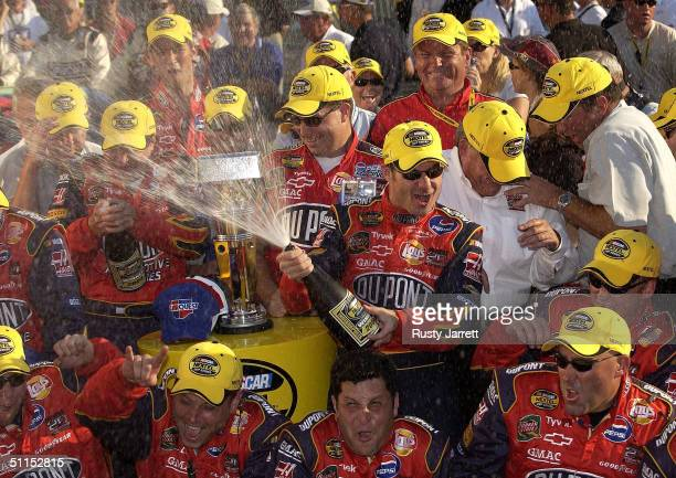 Jeff Gordon driver of the Dupont Chevrolet celebrates on the victory podium after winning the the NASCAR Nextel Cup series Brickyard 400 on August 8...