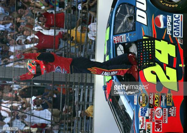 Jeff Gordon driver of the DuPont Chevrolet celebrates winning the NASCAR Nextel Cup Series Brickyard 400 on August 8 2004 at Indianapolis Motor...