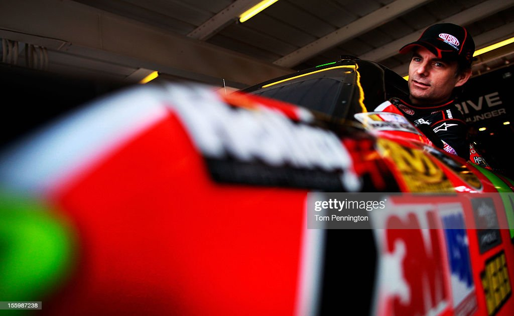 <a gi-track='captionPersonalityLinkClicked' href=/galleries/search?phrase=Jeff+Gordon&family=editorial&specificpeople=171491 ng-click='$event.stopPropagation()'>Jeff Gordon</a>, driver of the #24 DuPont Chevrolet, climbs into in his car during practice for the NASCAR Sprint Cup Series AdvoCare 500 at Phoenix International Raceway on November 10, 2012 in Avondale, Arizona.