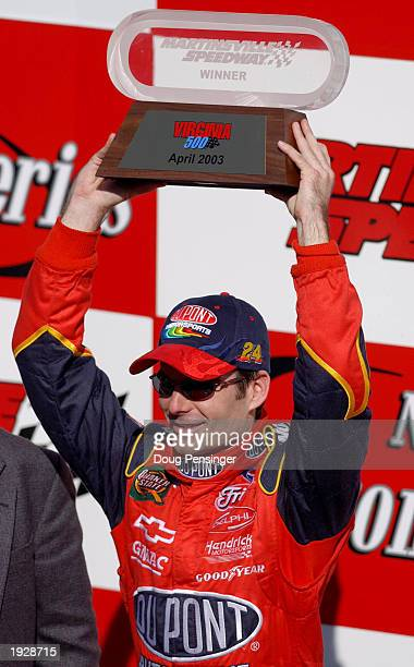 Jeff Gordon driver of the Dupont Chevrolet hoists the trophy after winning the NASCAR Winston Cup Virginia 500 on April 13 2003 at the Martinsville...