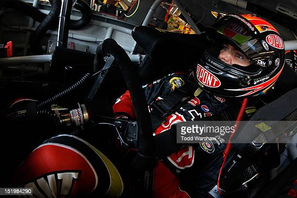 Jeff Gordon driver of the DuPont Chevrolet looks from his car on in the garage during practcie for the NASCAR Sprint Cup Series GEICO 400 at...