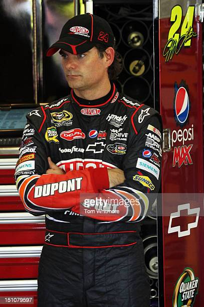 Jeff Gordon driver of the DuPont Chevrolet looks on in the garage during practice for the NASCAR Sprint Cup Series Advocare 500 at Atlanta Motor...