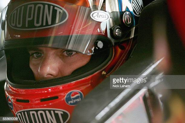 Jeff Gordon driver of the DuPont Chevrolet looks on in the garage during practice for the NASCAR Nextel Cup Series Sirius Satellite Radio at the Glen...