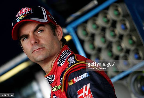 Jeff Gordon driver of the DuPont Chevrolet looks on while in the garage during practice for the NASCAR Nextel Cup Series Dover 400 on September 22...