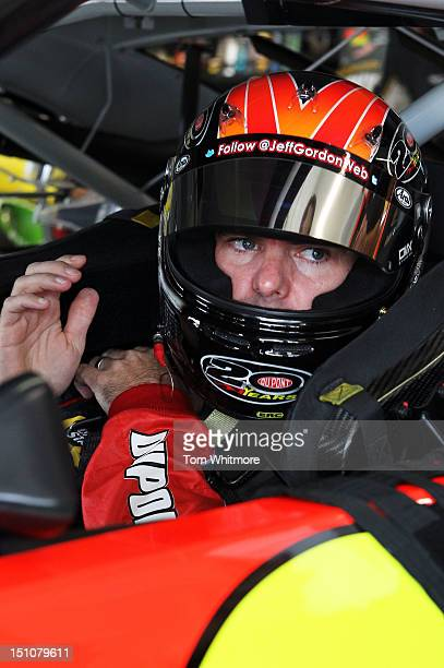 Jeff Gordon driver of the DuPont Chevrolet makes adjustments in his car in the garage during practice for the NASCAR Sprint Cup Series Advocare 500...