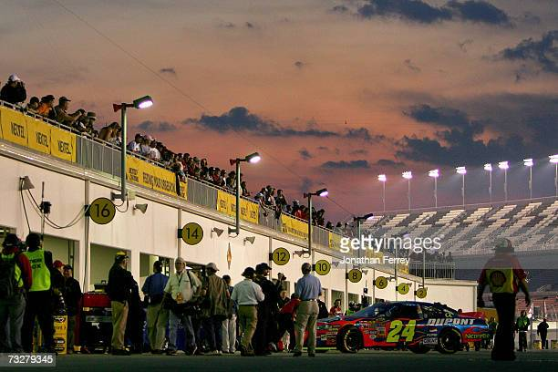 Jeff Gordon driver of the DuPont Chevrolet pulls out of his garage stall during practice for the Bud Shootout at Daytona International Speedway on...