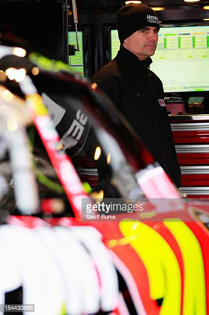 Jeff Gordon driver of the DuPont Chevrolet stands in the garage during practice for the NASCAR Sprint Cup Series Hollywood Casino 400 at Kansas...