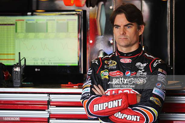 Jeff Gordon driver of the DuPont Chevrolet stands in the garage during practice for the NASCAR Sprint Cup Series AdvoCare 500 at Phoenix...