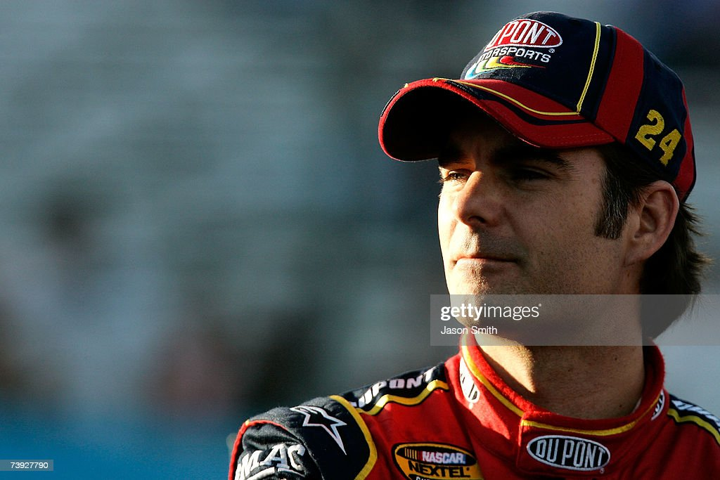 Jeff Gordon driver of the DuPont Chevrolet stands on pit road during qualifying for the NASCAR Nextel Cup Series Subway Fresh Fit 500 at Phoenix...