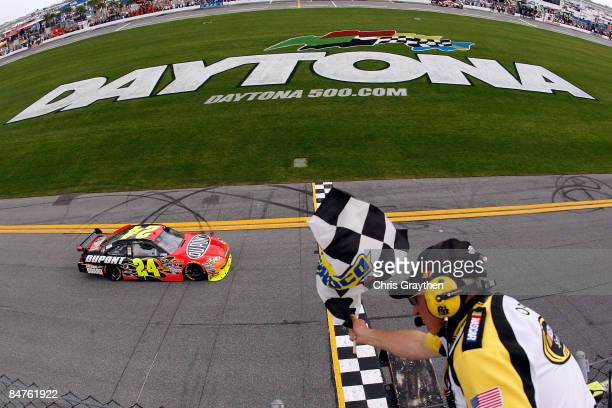 Jeff Gordon driver of the DuPont Chevrolet takes the checkered flag to win the NASCAR Sprint Cup Series Gatorade Duel 1 at Daytona International...