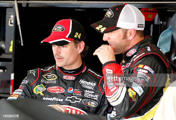 Jeff Gordon driver of the DuPont Chevrolet talks with crew chief Alan Gustafson in the garage during the NASCAR Sprint Cup Series GEICO 400 at...