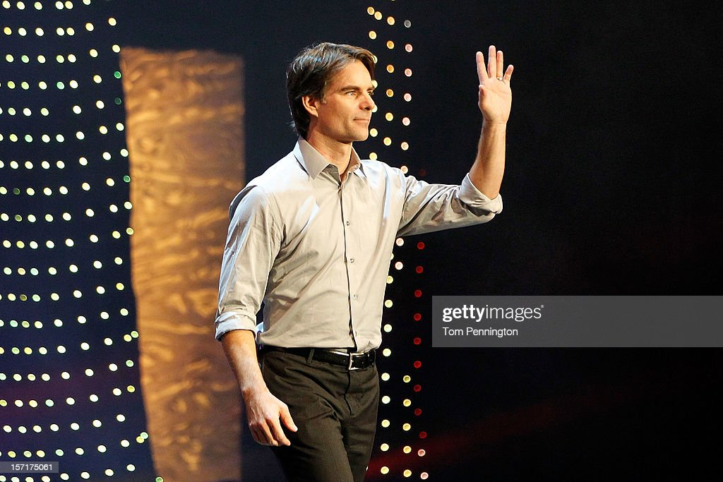 Jeff Gordon, driver of the #24 DuPont Chevrolet, waves to the fans as he walks on stage during NASCAR After The Lap at PH Live at Planet Hollywood Resort & Casino on November 29, 2012 in Las Vegas, Nevada.