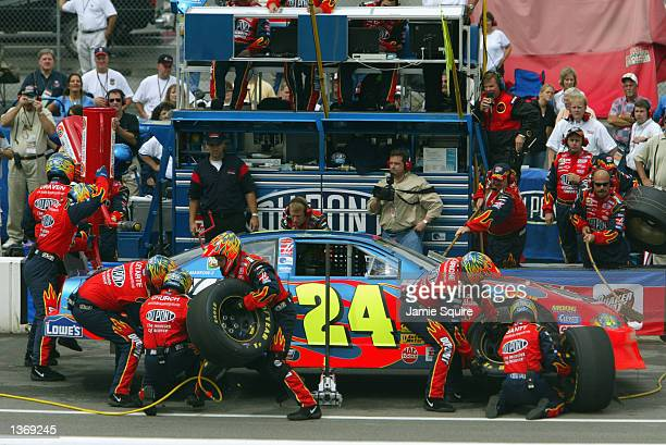 Jeff Gordon driver of the Hendrick Motorsports Chevrolet Monte Carlo comes in for a pitstop during the NASCAR Southern 500 on September 1 2002 at...