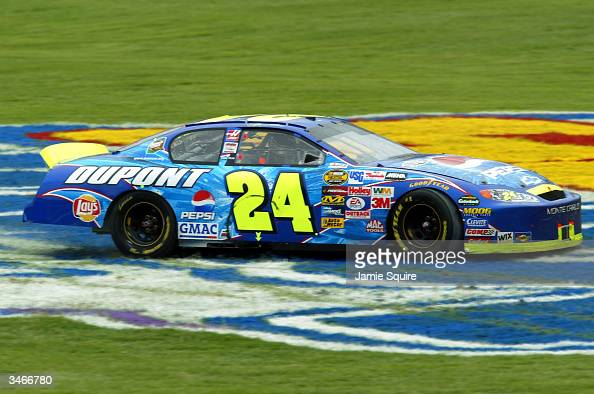 Jeff Gordon driver of the Hendrick Motorsports Chevrolet spins out in the infield after winning the Aaron's 499 on April 25 2004 at the Talladega...