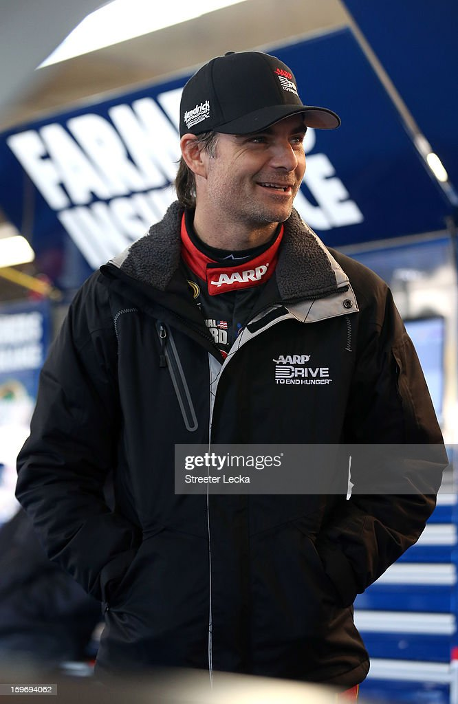 Jeff Gordon, driver of the #24 Hendrick Motorsports Chevrolet, stands in the garage during NASCAR Testing at Charlotte Motor Speedway on January 18, 2013 in Charlotte, North Carolina.