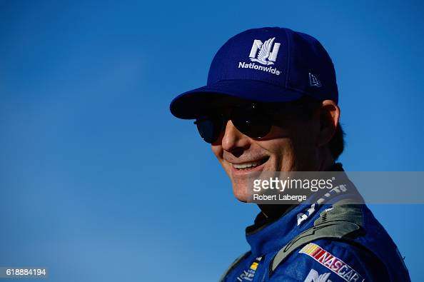 Jeff Gordon driver of the Nationwide Chevrolet stands on the grid prior to qualifying for the NASCAR Sprint Cup Series Goody's Fast Relief 500 at...